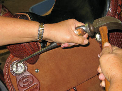 Caldwell Saddle - conchos repair